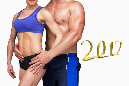 Bodybuilding couple against white background with vignette