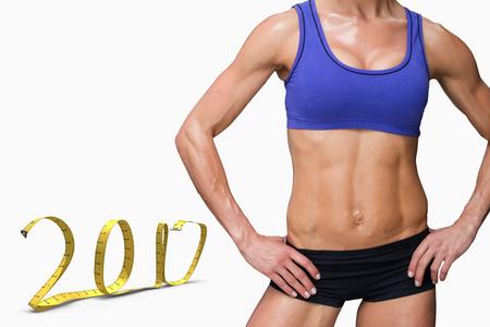 Female bodybuilder against white background with vignette