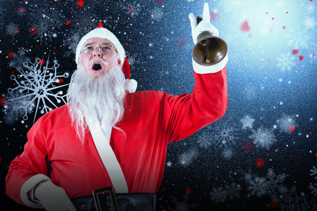 Santa claus ringing bell against snowflake pattern Stock Photo