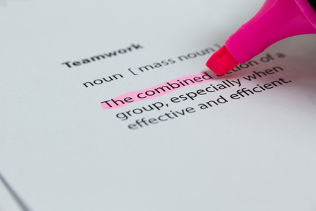 felt tip: The word combined highlighted in pink with felt tip pen Stock Photo