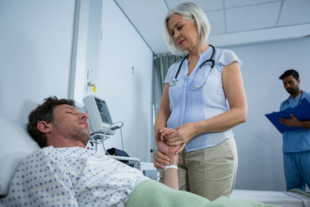 hospital patient: Doctor consoling a patient in hospital Stock Photo