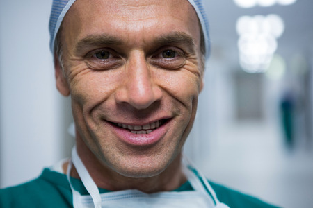 Portrait of male surgeon smiling in hospital