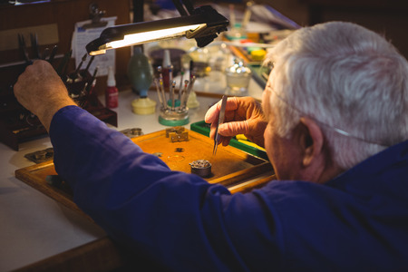 repairing: Horologist repairing a watch in the workshop Stock Photo