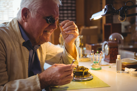 Horologist repairing a watch in the workshop Stock Photo