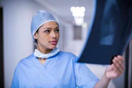 Female surgeon examining x-ray at hospital Stock Photo