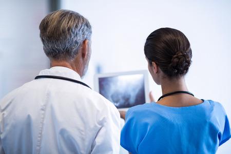 Doctor and nurse using digital tablet in hospital