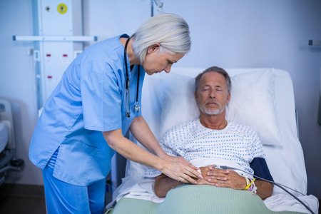 hospital patient: Nurse examining a patient in hospital Stock Photo