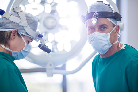 Surgeons performing operation in operation room at the hospital Stock Photo