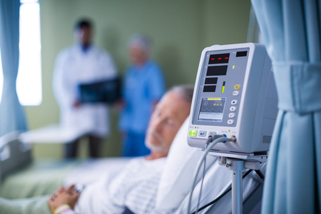 heart rate: Heart rate monitor and patient getting treatment in hospital