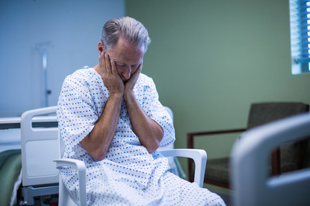 hospital patient: Sick patient sitting on chair at hospital