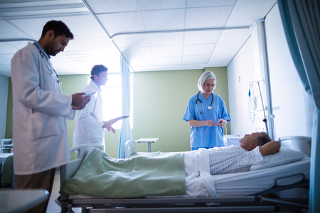 Doctor and nurse examining a patient in hospital