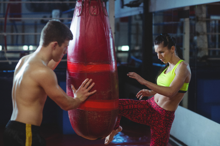 kick boxing: Female boxer practicing a kick boxing in fitness studio