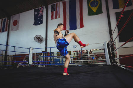 grappling: Confident boxer practicing a boxing in boxing ring