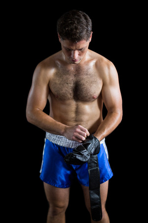grappling: Boxer wearing grappling gloves against black background Stock Photo