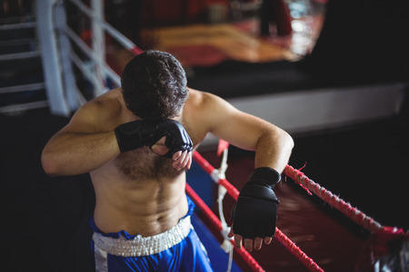 grappling: Depressed boxer posing after defeat in boxing ring