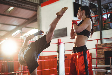Two female boxers fighting in boxing ring at arena Stock Photo