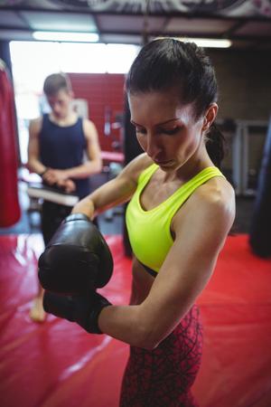 female boxer: Female boxer wearing boxing gloves in fitness studio