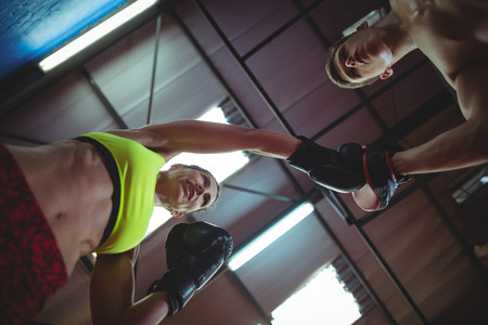 mitts: Boxers using focus mitts during training in fitness studio Stock Photo
