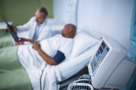 hospital patient: Patient monitoring machine in ward of hospital Stock Photo
