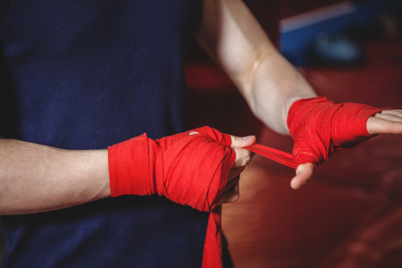 Mid-section of boxer wrapping boxing strap Stock Photo