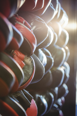mitt: Close-up of focus mitts and boxing gloves arranged in fitness studio Stock Photo