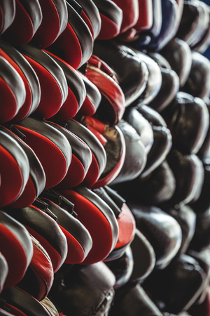 Close-up of focus mitts and boxing gloves arranged in fitness studio Stock Photo