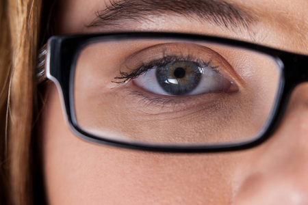 wearing spectacles: Close-up of beautiful eye of a woman wearing spectacles