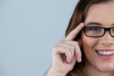 wearing spectacles: Portrait of smiling woman wearing spectacles Stock Photo