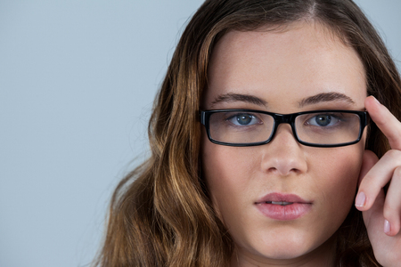 wearing spectacles: Portrait of beautiful woman wearing spectacles Stock Photo