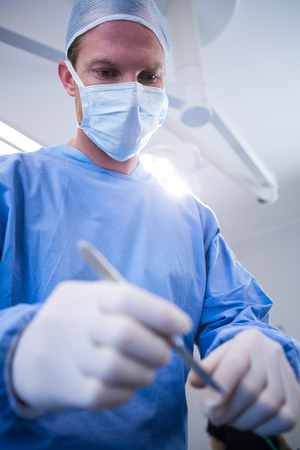 Surgeons performing operation in operation theater at hospital Stock Photo