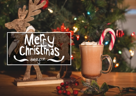 Merry christmas message against christmas decoration and hot chocolate with marshmallows