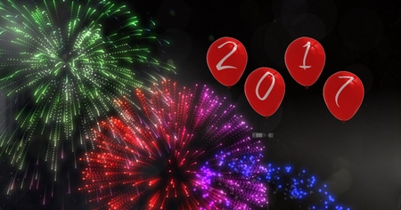 out of shape: 2017 as balloons against a composite image 3D of fireworks at night Stock Photo