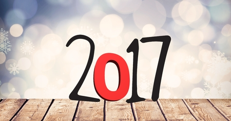 2017 on wooden plank against a composite image 3D of bright bokeh lights
