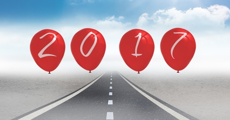 2017 as balloons against a composite image 3D of road in blue sky
