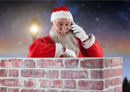 entertaiment: Santa claus inside a chimney talking on mobile phone at night