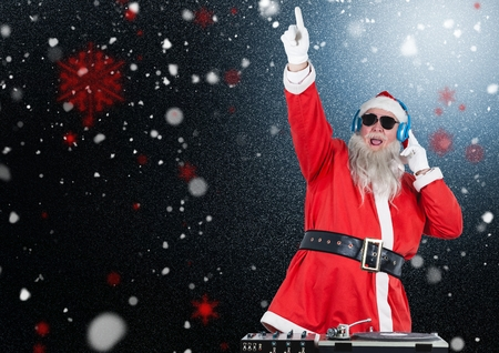 dj santa claus mixing up some christmas songs against black background stock photo 66679617 - Black Christmas Songs