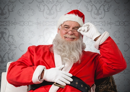 wearing spectacles: Portrait of happy santa wearing spectacles against grey background Stock Photo
