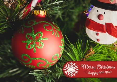 Composite image of merry christmas and happy new year message against christmas decoration Stock Photo