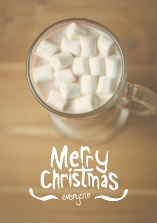 domicile: Digitally composite image of merry christmas message against a cup of hot chocolate with marshmallows