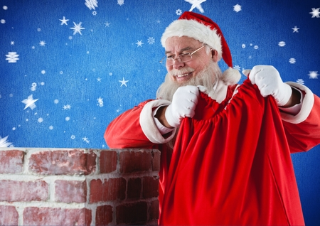 Santa claus placing his gift sack into the chimney against digitally generated blue background