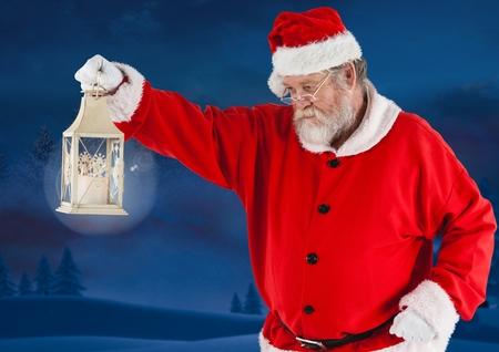 br: Santa claus holding a christmas lantern at night