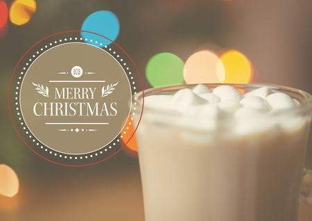 Digitally composite image of merry christmas message against a cup of hot chocolate with marshmallows