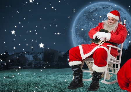 Santa sitting on chair and sleeping at night Stock Photo