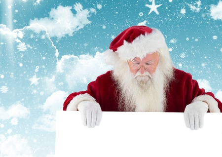 Santa claus looking down at white placard against digitally generated christmas background