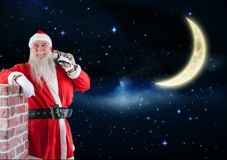 Happy santa claus standing with gift sack against digitally generated night background Stock Photo