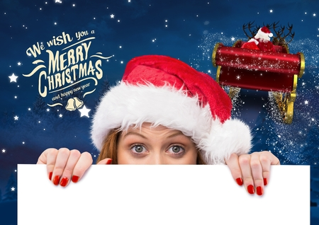 shinning: Woman in santa hat holding placard during christmas time