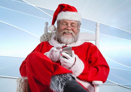 Santa claus using mobile phone against digitally generated background