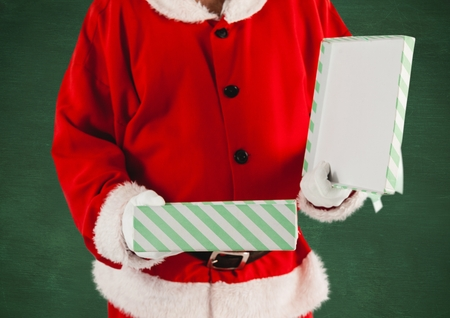 Santa claus holding a opened gift box Stock Photo