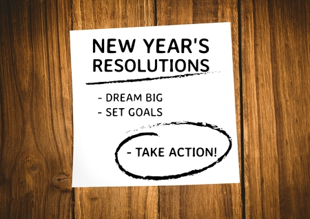 paper wad: New year resolution goals written on sticky notes against wooden background