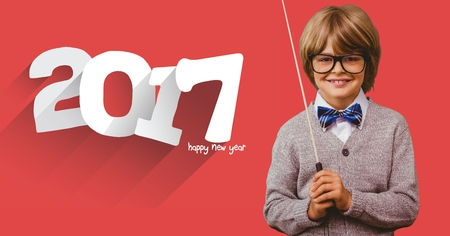 make believe: Smiling boy with stick standing next to 2017 message against red background